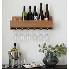 A space saving wall rack stores wine and glasses in straightforward, farmhouse kitchen style. Lines up a half case of the grape, with half dozen stemmed glasses suspended below. Made from acacia, a wood noted for its attractive grain. Hanging Wine Glass Rack, Wine Glass Shelf, Wine Shelves, Wine Glass Holder, Wine Storage, Glass Shelves, Secret Storage, Wine Wall, Extra Storage