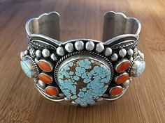 Cuff | Darrell Cadman.  Sterling silver, Mediterranean coral, Lone Mountain Turquoise.
