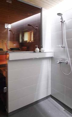 shower / sauna---with side half wall instead of full glass door