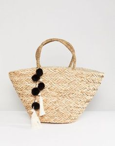 9d12fa0f39 South Beach Straw Beach Bag With Black   White Pom at asos.com
