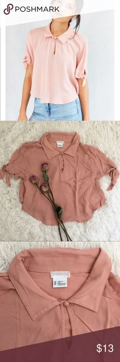 UO Cooperative blush tie sleeve collared blouse Crop length. Ties on sleeves, super cute button keyhole neckline. A little wrinkly from storage but almost no flaws. Purchased for $54 Message me for questions/measurements Urban Outfitters Tops Crop Tops