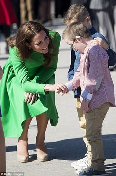 Kate greets Sebastian and Oliver, who helped her and William plant a tree in Canberra this... http://dailym.ai/1f5AHHU#i-ab9e0e7e
