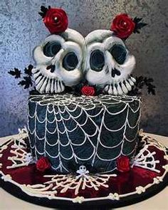 Spooky black two skulls wedding cake, decorated with spider webs and ...