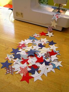 July 4th starriness... Kids will have fun paper-punching stars from red, white, and blue print papers. Then, quickly zip together on sewing machine. Great to drape across tree branches, shrubs, staircase, fireplace mantle, tops of doorways, top of pergola or patio, etc.