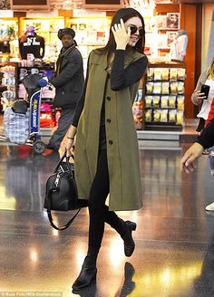Always done up: The day before the cover girl was seen at the airport wearing an olive green coat