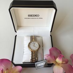 New in box Seiko Watch with 18 kt gold accents Seiko Watch. 18 kt gold accents around bezel and band. The rest is stainless steel. This one was a display model so there is some light scratching from trying on. Needs a new battery! In box with Seiko booklet. Large size, could be men's or women's depending on styling. Make me an offer using the offer button! Seiko Accessories Watches