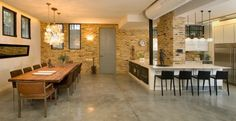 Love the concrete floors, exposed duct work, and exposed brick