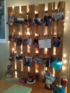 Grab a used pallet for free from nearly any home improvement store and hide Christmas lights behind it! It creates an eclectic board for hanging photos.