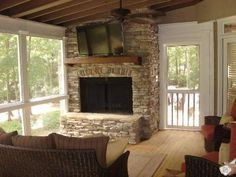 Macon GA screened porch with outdoor fireplace and TV. Would be nice to have the fireplace go both ways. Porch Wood, Porch Fireplace, Fireplace Ideas, Building A Porch, Building A House, Sliding Screen Doors, Screen House, Screened In Patio, House With Porch
