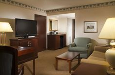 """Every Suite of our Dulles Airport hotel features a full living room with a pull out sofa, mini fridge, coffemaker and micro-wave.  Plus a 42"""" flat screen TV. Also a seperate work area with table and chairs."""