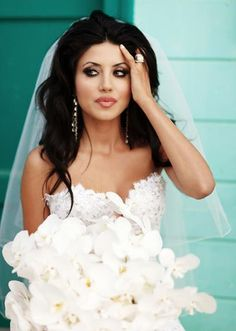 leyla milani...like to top of the dress, wish I could see the rest but the bouquet is too big.