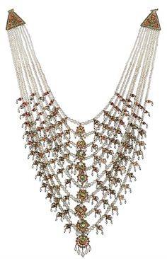 AN IMPOSING ANTIQUE INDIAN NATURAL PEARL NINE-ROW NECKLACE. In the style of a 'Satlada' necklace designed as a cascade of nine pearl strands each suspending a fringe of pearl, enamel and white gem-set plaques to the triangular-shaped gem-set clasp, circa 1880, 50.0 cm long, 38.0 cm drop.