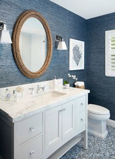 Navy Bathroom with Rope Mirror... http://www.completely-coastal.com/2016/09/nautical-living-navy-blue-white.html