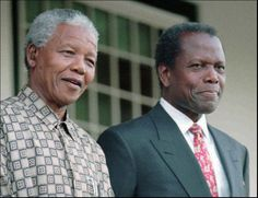 In this May 17, 1996 photo, South African President Nelson Mandela, left, and actor Sidney Poitier appear at a news