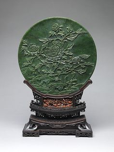 Table Screen with Tree Peonies    Period:      Qing dynasty (1644–1911)  Date:      18th century  Culture:      China  Medium:      Jade (nephrite); rosewood stand