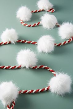 Candy Cane Pom Garland, presented by Anthropologie. Fluffy faux fur poms adorn this candy cane-striped garland, making it a sweet addition to your mantelpiece or tree. Christmas Mantels, Gold Christmas, Christmas Home, Christmas Crafts, Christmas Ornaments, Candy Cane Christmas Tree, Modern Christmas, Anthropologie Christmas, How To Make A Pom Pom