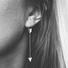 Lightweight mixed metal arrow earrings. Hand cut sterling silver arrowhead, 14k gold fill shaft and brass fletching (feathers). Three pivot points allow for gentle movement in the earrings. 14k gold fill ear wires. Available as single earring or a pair.