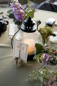 Amazing Lantern Wedding Centerpiece Ideas ★ lantern wedding centerpiece round lantern with a candle and a table number surrounded by flowers brent gulledge photography Rustic Lantern Centerpieces, Rustic Lanterns, Wedding Lanterns, Wedding Table Centerpieces, Flower Centerpieces, Wedding Decorations, Table Decorations, Centerpiece Ideas, Lanterns Decor