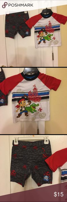 Disney Jake & the Netherlands pirate boy's 2pcs se Preowned Disney Jake and the Netherlands pirates 2pieces boys shorts and top set. Top features short sleeves, round neck and its screen print design features Jake, croc and the pirate ship. Double stitching at the sleeves and crew neck collar adds detail and durability to this soft knit tee. Short features clip button, elastic waist at the back, 5 pockets and skeleton prints all over short. Color white/red/black/grey. Worn once from a clean…