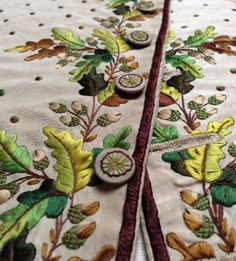 Embroidered oak leaf and acorn design on a cream silk tabby waistcoat, 1780-90, in the Wade collection. ©National Trust