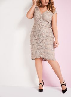 Lace Dress designed with extended shoulder.