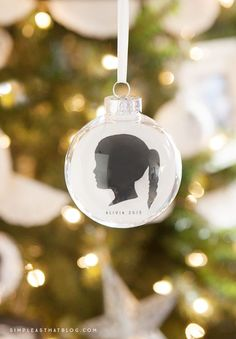 These simple, DIY, silhouette keepsake ornaments will help you capture a moment in time as you display your children's profiles year after year on your Christmas tree. MichaelsMakers Simple As That Blog