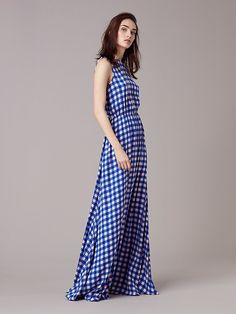 Cut in 100% silk in exuberant prints, this floor-length dress features a faux wrap style bodice, hidden side seam pockets, and a cinched waist and seam detailing at the sides for a beautiful, undulating draping effect.