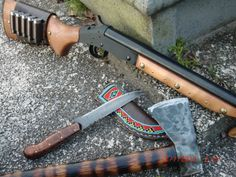 """Fusil De Pardner"" Modified HR 12G Shotgun With Montana Americana knife and Unknown Tomahawk. Note the Brass Tack and Steel Stud work on the fore grip. On the ButtStock is a leather shell holder with 5 Lane Arms cartridge adapters."