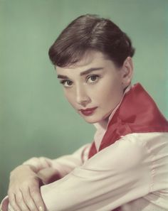 1955. Looking glamorous with a red scarf and matching lipstick