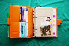 orange filofax / planner / organization / personal / color-coded tabs and labels / photos