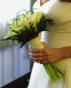 White mini calla lillies hand tied in ivory organza ribbon and criss crossed above with bear grass
