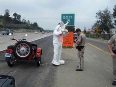 Man riding motorcycle in Easter Bunny costume gets pulled over for best Easter photo ever.
