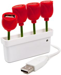 Kikkerland Tulip USB Port: Transform your desk into a beautiful garden with the new USB Tulip Hub. Featuring four tulip bulbs, each bulb can be used to connect a USB device to your computer. Bring some color to your clutter! For Mac and PC. $ 10.