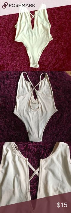 Cream Deep V Bodysuit Bodysuit is thin and very stretchy. Bottoms are thong. Super sexy and super low V in front. Back is strappy and fun. So cute layered under a leather jacket or with some high waisted shorts. Labeled L could fit a medium/large. Never worn. Tops