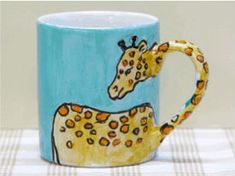 Giraffe Mug -- You could do this with so many different animals! Elephants, whales, lions' tails! Love this!