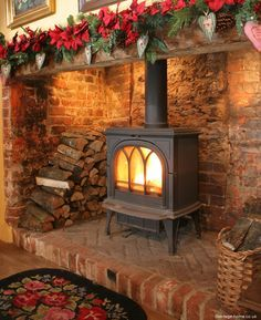 Wood burn stove in fireplace. I love the openess of this fireplace. Inglenook Fireplace, Fireplace Hearth, Stove Fireplace, Fireplace Design, Fireplace Ideas, Brick Fireplaces, Fireplace Lighting, Fireplace Decorations, Wood Stove Hearth