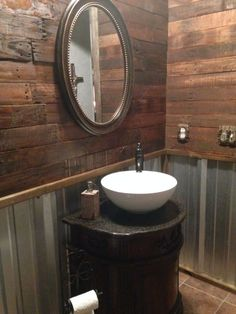 Remodel, rustic bathroom with pallet wall and corrugated tin. by marissa