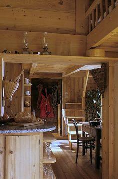 Raw pine interior, wall baskets. Chalet in Chamonix, France