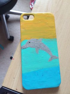 DIY: Ombré dolphin phone case. All you need is 4 types of acrylic paints, paint brush, make-up sponge, grey sparkly nail polish, iPhone case, and clear top coat nail polish. Hope y'all enjoy.