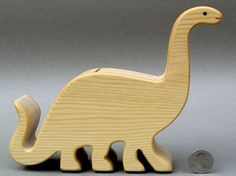 Brontosaurus Piggy Bank Wooden Coin Bank for by ArksAndAnimals, $20.50 - so many other great wooden toys as well