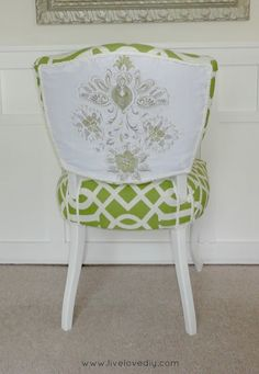 Upholstery Tips & Tricks | LiveLoveDIY. I like the way she used a different fabric on the back of the chair.