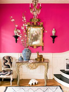 Pink Foyer: The entry of a late-19th-century house in Brooklyn decorated by Jonathan Berger is a showstopper, with walls in Benjamin Moore's Razzle Dazzle. The table and side chair — covered in vintage needlepoint — are Louis XV, and the mirror is 18th-century Italian.