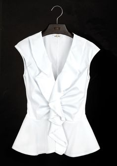Fotogalería: Las blusas blancas de Carolina Herrera - Vanidades