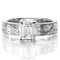 Design 3063 features a regal 1.00 carat emerald-cut central diamond. The long rectangular diamond facets contrast beautifully with its delicately engraved band.   http://www.knoxjewelers.biz/