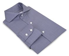 Luxire dress shirt constructed in Monti Navy White Houndstooth: http://custom.luxire.com/products/monti-navy-white-houndstooth  Consists of cutaway collar and 2 button cuffs.