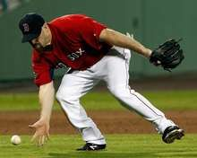 Kevin Youkilis of the Boston Red Sox fields a ground ball against the Pittsburgh Pirates during a spring training game.  http://www.fansedge.com/Kevin-Youkilis-Boston-Red-Sox-392012-_-175521532_PD.html?social=pinterest_mlb_32312_youk  #MLB  #RedSox