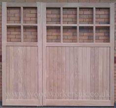 Custom garage doors, one bigger than the other