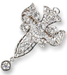 A Belle Époque diamond set brooch pendant, set overall with graduated old circular cut diamonds in a pierced platinum mount. Folding pendant loop. 5cm high.