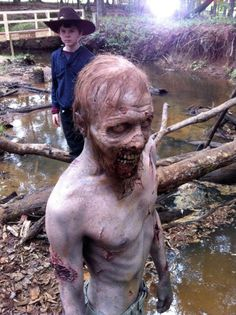 The Walking Dead Behind the Scenes Photos Swamp Walker (Kevin Galbraith) makeup by Kevin Wasner (Special FX Makeup Artist) with Chandler Riggs (Carl) in the background
