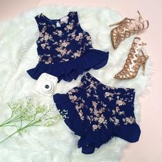 Lace is so on trend this season! This blue, two piece set is paired with gold heels for a stylish, dressed-up look.